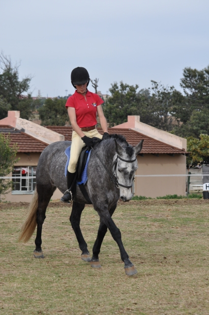 May 2014, winning our first dressage show. We look better, but my toe and my eyes and my hands and my shoulders... And Arwen is quite far on her front end and quite heavy in the contact.